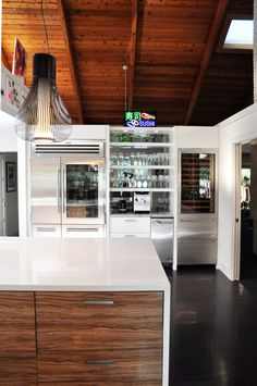 beautiful modern kitchen remodel - stainless steel appliances, dark tile flooring, wooden cabinets, white countertops, high wooden ceilings... by the BEST custom construction company in central Florida | www.allinconstruction.com