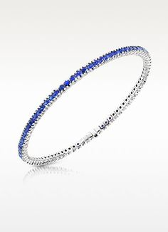 €4002.00   Bright blue sapphires adorn this beautiful tennis bracelet, perfect for the woman contemporary elegance and classic, refined tastes. CTW 3.16. Signature box included. Made in Italy.