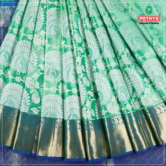 The blue shimmering work on the weaves elevates the entire #kanchipuram #silksaree to a whole new level. The white peacock work on the body of the saree is unique looks simply exemplary. Wrap around this saree and look gorgeous.  #kanchipuramsilks #pothys #weddingsilks #Greensilksaree #bluesaree #weddingsaree #saree #kanchipurampattu #silkblouse #weddingblouse