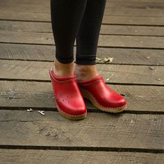 A little splash of color makes me smile #redclogs #blackandred #clogs…