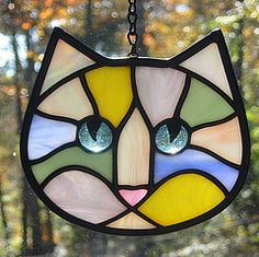 its not even winter, and i'm already thinking of spring colors.    this is brand new idea-using pastel colored glass for the stained glass kitty cats~~i'd love to get some opinions on this...     Kitty cat :-)