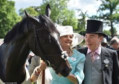Thrilled: Lord Andrew Lloyd-Webber and his wife celebrate with their filly The Fuge, who triumphed in the G1 Prince of Wales's Stakes on day two at Royal Ascot, 2014