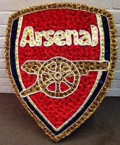 Arsenal football badge funeral flowers.
