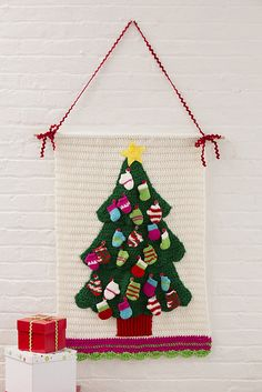 Christmas Tree Wall Hanging Free Crochet Pattern in Red Heart Holiday and Red Heart Super Saver yarn Crochet Christmas Trees, Christmas Tree Pattern, Christmas Crochet Patterns, Holiday Crochet, Christmas Knitting, Christmas Tree Ornaments, Christmas Ideas, Xmas, Crochet Advent Calendar