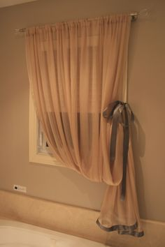 French Inspiration - Ensuite curtain in taupe chiffon with violet twilight satin ribbon & adorned with crystal finials.
