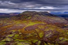 The living Earth...  Less than 20min away from Reykjavik. The weather conditions were as strange as the autumn-touched landscape. It was a struggle with lights, shadows and the shaky flight by Daniel Herr on 500px.