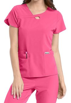 The Med Couture Flex Lola Keyhole Scrub Top includes roomy pockets and stretch fabric. Shop for yours at Scrubs & Beyond. Staff Uniforms, Medical Uniforms, Nursing Clothes, Nursing Dress, Stylish Scrubs, Scrubs Outfit, Tulip Sleeve, Hippie Look, Medical Scrubs
