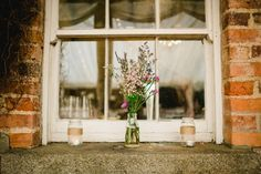 Wild flowers display for an outdoor spring wedding | Photography by http://www.wearethelous.com/