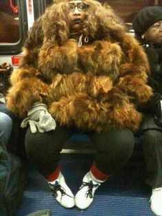 Sasquatch or Chewbacca? Fur Coat Fashion Fail ---- funny pictures hilarious jokes meme humor walmart fails
