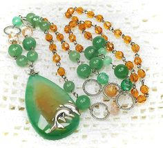 """Long necklace & earrings """"Amber green"""".  Made by crackle agates,  nephrite beads, facetted crackle agates, crystals and metal findings."""