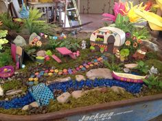 Fairy garden in an old rusty wheelbarrow!