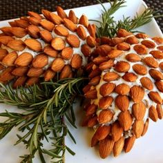 "Cute Christmas Appetizers - Almond and cheese ""pine cones"""