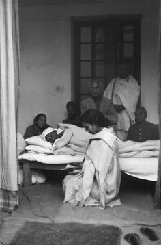 Magnum Photos Photographer Portfolio  Henri Cartier-Bresson INDIA. Delhi. Birla House. 1948. GANDHI on last day of his fast, the day before his assassination.