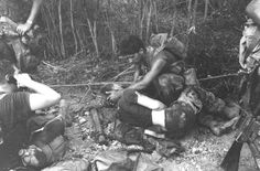 OPERATION OKLAHOMA HILLS – HM3 N. W. Jones, a corpsman attached to B Co, 1st Bn, 7th Marines, treats a wounded Marine. [1969]