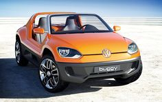 Volkswagen Buggy Up Concept.  Based on the company's new Up! city car and inspired by the Beetle-based beach buggies of the '60s, the Buggy Up features a reinforced underbody, a roof-less and door-less exterior, neoprene-covered seats, a completely waterproof interior, and an iPod-powered infotainment system that pulls out to serve as a portable sound system. Sadly, there's no word yet on a production model, but you can put us down for one if/when it ever appears.