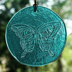 """Butterfly+Suncatcher+-+<span+class=""""clearance"""">New+Lower+Price!A+breath+of+Spring+in+teal+glass.+Approx.+4""""+in+diameter.+Comes+with+a+hemp+cord+and+glass+beads+for+hanging."""
