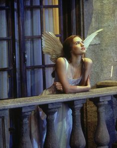 <3 Claire Danes, from Romeo + Juliet. Adore this dress. Have black feather wings, will travel.