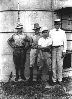 Men standing by a silo by State Library and Archives of Florida