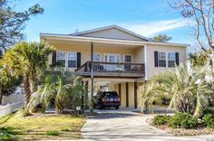 North Myrtle Beach Raised Beach House Located just a few blocks from the ocean along a quiet avenue in the windy hill section (no HOA) of North Myrtle Beach, this 4 bedroom 3 bathroom raised beach house is a must see!