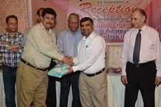 Mr. Saleem Karim giving Suvinour to Mr. Jameel Ahmed KCCA