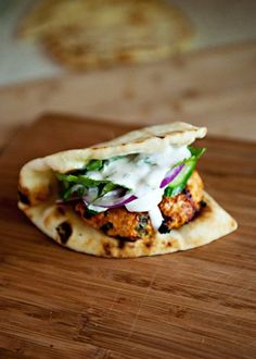 Tandoori Chicken Burger. I *love* the smart hybrid of chicken burger. tandoori and yogurt and naan as bun. I can't wait to try this.