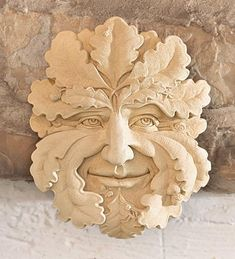 Green Man Handcast Stone Sculpture...The Green Man is an ancient Celtic archetype whose origins are lost in the mists of time. A human face of foliage, he represents the unity between man and vegetation. Some call the Green Man the male counterpart to Gaia, the Mother of the Earth. His carved image is found in religious architecture all over Europe, historically representing renewal and rebirth, and the mischievous, irrepressible spirit of nature.