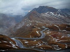 Col du Galibier pass : Grande Alpes (Alps) road: Galibier road, alpine lawns dotted with snow and mountains