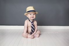 6 month old boy in hat and tie