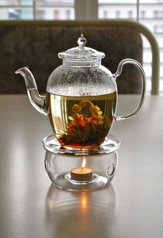 TEA AND HAPPINESS contemplating blooming tea