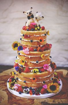 Add bold and beautiful flowers to your naked cake and complete your colour pop wedding theme