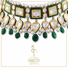 This Pinkcity gold choker is crafted with pearls, emerald beads and polki.