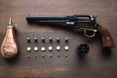 Anatomy of loading a Remington 1858: Powder Flask, six lead balls, six over-powder wads, six percussion caps, and the cylinder to pack it all into. Be sure to load the components in the proper order :)