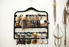 "Tour Fashion Blogger Danielle Bernstein's Apartment - Her Organizer  ""I decided that I wanted to display my sunglasses and bracelets in a cool way. I came across this extra pants hanger and realized how crafty it would be to use it for my accessories."""