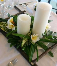 tropical theme wedding centerpeices | ... theme-oriented items below the water level. Wide bowls accommodate a