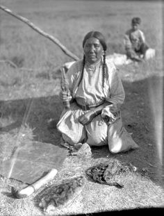 Unidentified Blackfoot woman with hide-scraping tools - Alberta