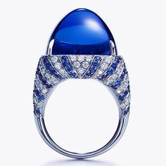 TIFFANY & CO. Sugarloaf Tanzanite ring in platinum with a 32.27-carat sugarloaf tanzanite, diamonds and sapphires.