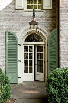 Applause to everything about this photo. The shutters, the doors, the brick, everything. French Doors, Cottage Style, Georgian Homes, House Exterior, Exterior Design, Front Door, Exterior Doors, Green Shutters, Doors