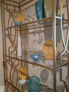 Beautifully gold bookcase from Century Furniture #HPMKT Leslie