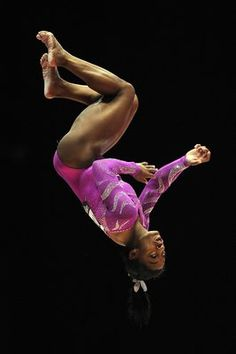 US gymnast Simone Biles competes on the beam on the second day of the 2015 World Gymnastics Championships at the Hydro Arena in Glasgow, Scotland on October 24, 2015. Gymnasts can secure qualification for the 2016 Olympic Games in Rio de Janeiro at the championships. AFP PHOTO / ANDY BUCHANAN        (Photo credit should read Andy Buchanan/AFP/Getty Images)