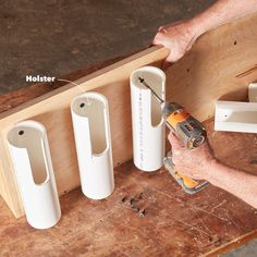 Woodworking Designs PVC pipe holsters project - Learn how to build a drill dock organizer to keep your workshop neat and clutter free! Power Tool Storage, Garage Tool Storage, Workshop Storage, Garage Tools, Garage Workshop, Diy Storage, Power Tools, Pvc Pipe Storage, Power Tool Organizer