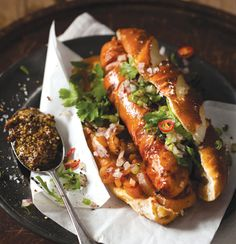 Gourmet hot dog with red onion, chilli and coriander salsa
