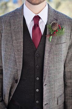 Love this wintery groom look with pine cone boutonniere