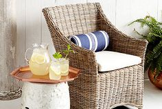 Love a simple wicker chair on the porch...also a great host and hostess chaired when paired with four other upholstered skirted chairs..