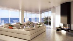 Home Design Grey Sectional Sofa Also Armchairs Among Glass Coffee Table Modern Paint in Seaside House with White Wall