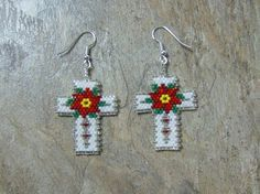 These pretty poinsettia cross earrings are done in the brick stitch with size 11 delica glass beads. The colors that I have used are brick red, red,