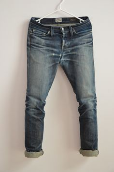 Name: Naked & Famous Denim x Blue in Green Rigid Deep Indigo Selvedge  Weight: 21 oz.  Denim: 100% Cotton  Fit: Low rise, tapered legs (Weird Guy cut)  Length of Wear: 16 months and counting  Number of washes: 1 wash at the one year mark