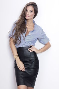 Leather skirt paired with a blouse. Hot!