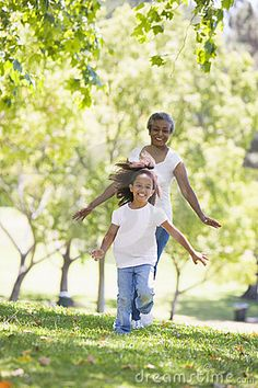 Grandmother and granddaughter running in park and. Grandmother and granddaughter ,