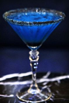 Witches Brew  Bacardi Dragon berry rum  Blue Curacao  Creme de banana  fresh squeezed lime juice  served up in a martini glass rimmed with black sugar.