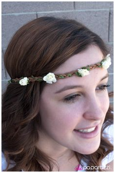 Delicate white flowers link into an eye-catching headband. Strips of brown leather braid around a strand of green leaves in a genuinely earthy hippie style. justtherightbling@msn.com